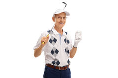 Senior golfer holding a golf club and a ball. Studio shot of a senior golfer holding a golf club and a ball isolated on white background Stock Photos