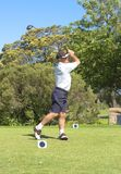 Senior golfer playing golf. Senior male golfer playing golf from the tee box on a beautiful summer day Stock Photography