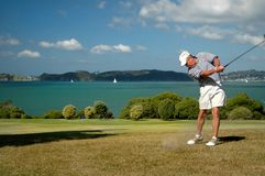 Senior Golfer swings Stock Photo
