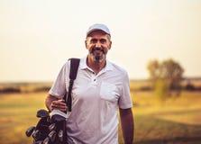 Free Senior Golfer Walking On Golf Court With Bag Royalty Free Stock Image - 214378746