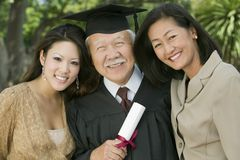 Senior Graduate with granddaughter and daughter outside portrait Royalty Free Stock Photography