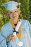 Senior Graduate Holding Diploma Outside Stock Photo