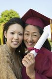 Senior Graduate hugging daughter outside Stock Images