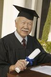 Senior graduate at podium outside Stock Photo