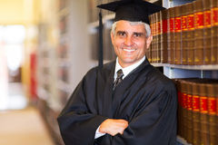 Senior graduate. Portrait of senior graduate with arms crossed in library Royalty Free Stock Photos
