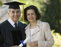 Senior Graduate and Wife outside Royalty Free Stock Images