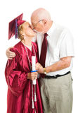Senior Graduation Couple Kissing Royalty Free Stock Photography