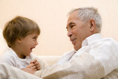 Senior and grandchild. Adult senior play about with his grandchild royalty free stock photography