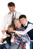 Senior with grandchildren and doctor Royalty Free Stock Photography