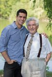 Senior grandfather and mature grandson Royalty Free Stock Image