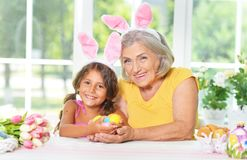Senior grandmother and granddaughter with  Easter eggs royalty free stock photos