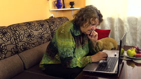 Senior grandmother woman type on laptop computer keyboard. Senior grandmother woman type on laptop notebook computer keyboard at home. Approach shot on Canon stock footage