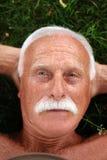Senior on grass. In garden Royalty Free Stock Image