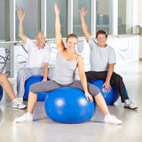 Senior group doing back training exercises in gym Royalty Free Stock Image
