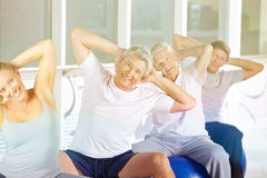 Senior group doing back training Royalty Free Stock Images