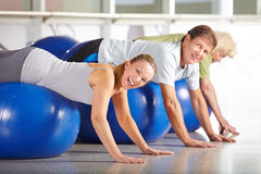Senior group doing back training in health club. Happy senior group doing back training in health club on gym ball Royalty Free Stock Image
