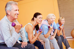 Senior group with dumbbells. Senior group exercising with dumbbells in a health club Stock Images