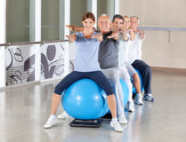 Senior group exercising in fitness Stock Photo