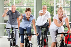 Senior group in gym holding thumbs Royalty Free Stock Photo