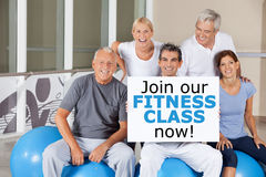 Senior group holding Join now sign Stock Images
