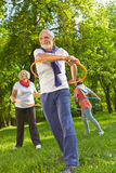 Senior group with hoops in a fitness class stock photos