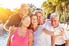 Senior group makes selfie on vacation. By the pool royalty free stock photography
