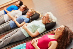 Senior with a group meditating Royalty Free Stock Images