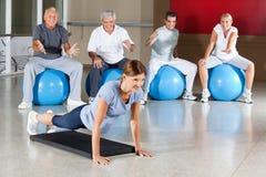 Senior group motivating woman Stock Image