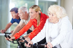Senior group in spinning class in rehab center Stock Images