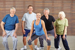 Senior group taking dancing lessons in gym Royalty Free Stock Image