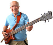 Senior guitar man. Smiling elderly man holding an electric bass guitar isolated on a white background Royalty Free Stock Image