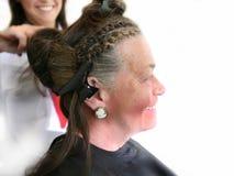 Senior by hairdresser Stock Images