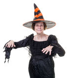 Senior in Halloween witch costume Stock Photo