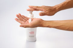 Senior Hand Applying Lotion Stock Photography