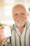 Senior hand in focus holding medicine phial stock images