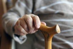 Senior hand holding cane Royalty Free Stock Photos