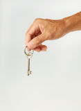 Senior Hand Holding Key Stock Image