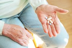 Senior hand holding medications top view close up Stock Images