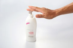 Senior Hand With Lotion Stock Images