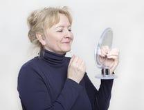 Senior with hand mirror Stock Photos
