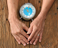 Senior hand and old clock Stock Image