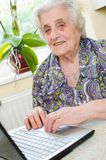 The senior hand presses the laptop keyboard. Button Royalty Free Stock Images