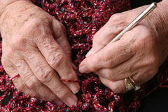 Senior hands. Senior or grandmother's hands crocheting royalty free stock image