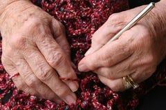 Senior hands. Senior or grandmother's hands crocheting Royalty Free Stock Image