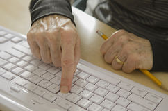 Senior hands on keyboard Royalty Free Stock Photos