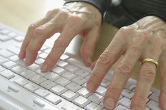 Senior hands on keyboard Royalty Free Stock Images