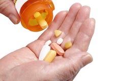 Senior hands and pills Stock Photo