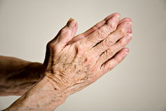Senior hands praying Stock Photography