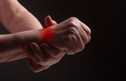 Senior hands. Suffering from pain and rheumatism Stock Images