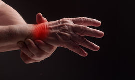 Senior hands. Suffering from pain and rheumatism Royalty Free Stock Images